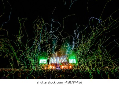 DJ Concert Festival with Special Effects Streamers and Fireworks over the Crowd.