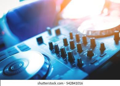 DJ console cd mp4 deejay mixing desk in nightclub. selective focus on button.