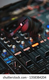 DJ equipment. Player and mixing console with headphones. Night club, music and DJ performance. Nightlife, learning concept. Soft focus and beautiful bokeh.