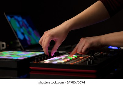 Dj hand remixing music on midi controller