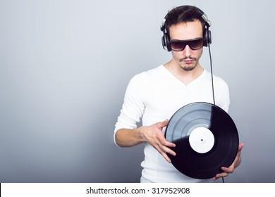 Dj with headphones and vinyl
