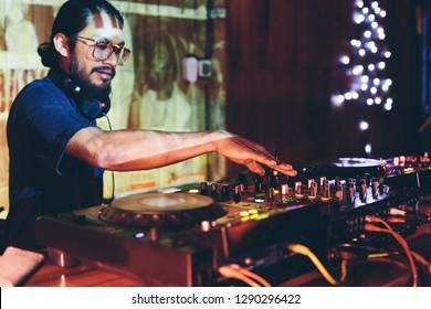 DJ man in night club on reggae party