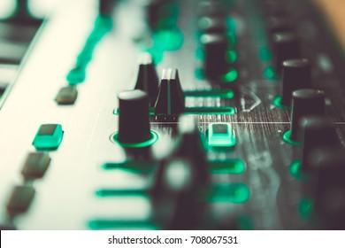 Dj midi controller in professional sound recording studio.Record a remix to electronic music track in studio.Pro audio equipment for composer.Compose & mix new edm music tracks on digital equipment