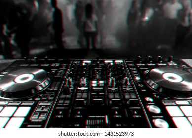 DJ mixer controller Board for professional mixing of electronic music in a nightclub at a party with dancing people in the background. Black and white photo with glitch effect and small grain