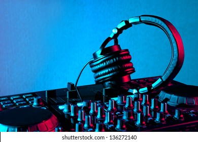dj mixer with headphones at nightclub party