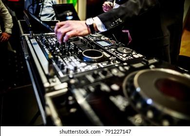 DJ mixer, DJ mix music on the console, the DJ's hand