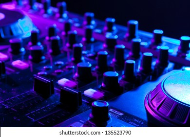 dj mixer in a night club