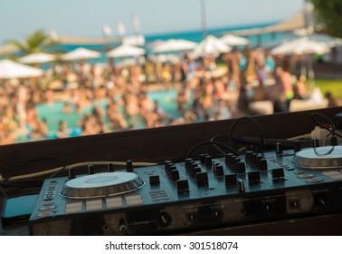 DJ mixer on pool party