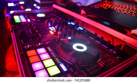 dj mixtable with colors in night club