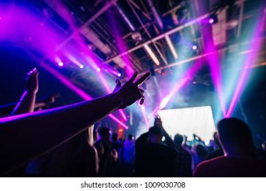 Dj party at nightclub. Crowd hand closeup. Lazer lights