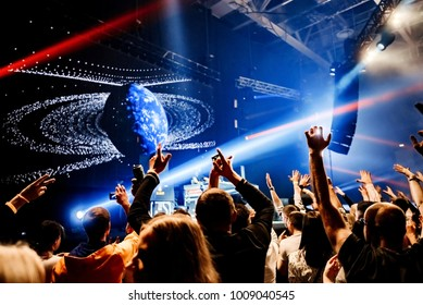 Dj party at nightclub. Crowd rave at the cosmic stage background