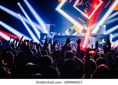 Dj party at nightclub. Crowd rave at the stage background. Stranger Dj's