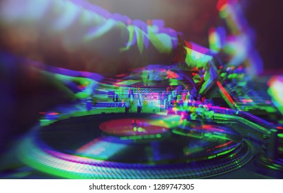 Dj party poster.Glitched background of parties djs playing music with professional turntables.Hip hop disc jockey mix musical track on concert.Vintage glitch filter effect,colorful blurred neon lights