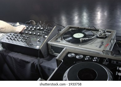 A DJ performs a sound check using professional equipment in a large music venue