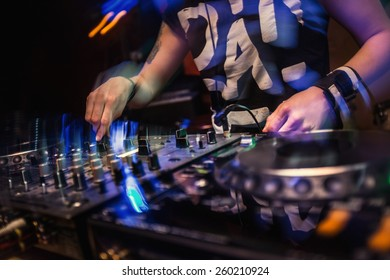 Dj playing disco house progressive electro music at the concert. DJ hands on equipment