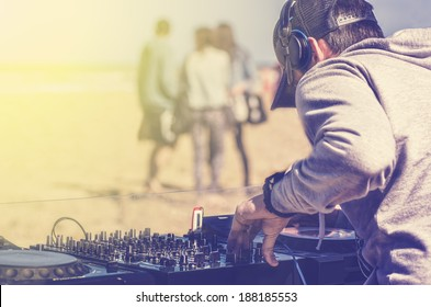 Dj playing music at a beach party
