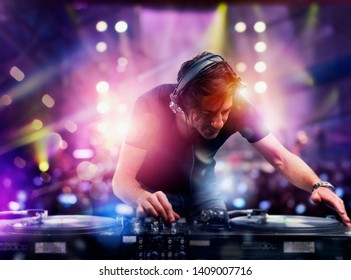 DJ playing music at the discotheque