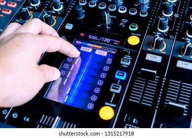 Dj playing music at mixer