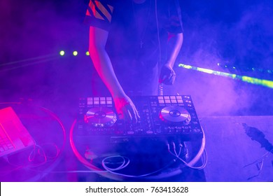 DJ playing music on light background