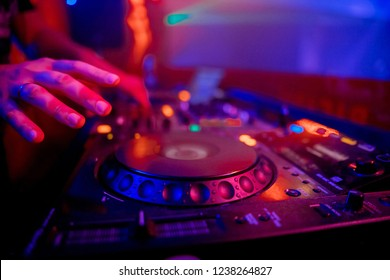 Dj playing the track in the nightclub at party closeup