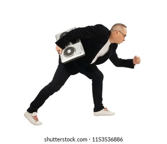 DJ runs with DJ control equipment in hand, black suit isolated on white background
