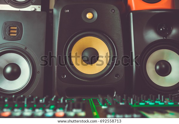 Dj shop stand with professional stereo monitors speakers.High quality speaker box for disc jockey to mix music tracks.Listen to songs in hi-fi quality on sound system