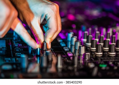 DJ sound equipment at nightclubs and music festivals, EDM, future house music and so on. Parties concept, sound technique. DJ playing on the best, famous CD players.