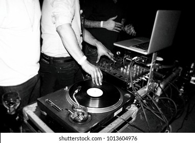 DJ spins records at a night club dance party