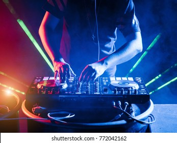DJ stage mixing on stage party in nightclub