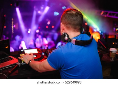 DJ stands before the mixer