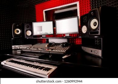 DJ Studio equipment. Mixing console on the table. Empty recording Studio room side view