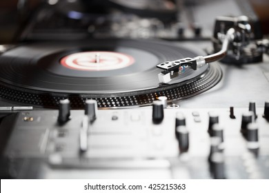 DJ turntable.vinyl record player,Professional equipment for sound recording studio, night club concert.Hip hop party hardware for disc jockey.Scratch records