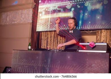 Dj at work in luxury nightclub during night party. Dj make party time at elite night club. Man at work as dj