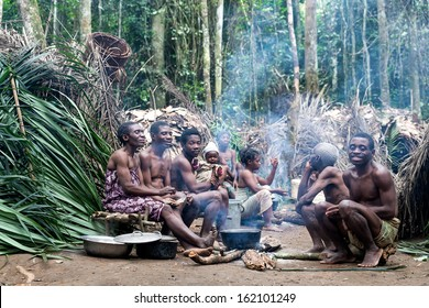 DJA FOREST, CAMEROON - AUG 5: Family of pygmies in the forest, forest pygmies Could Lose Their habitat due to logging companies and ivory traffickers on Aug 5, 2013 in the Dja forest, Cameroon