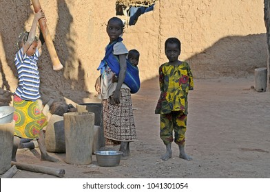 Djanne, Mali - December, 28, 2014: Young woman with child in a village of Mali