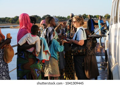 Djanne, Mali - December, 28, 2014: adult woman visit market along Niger river