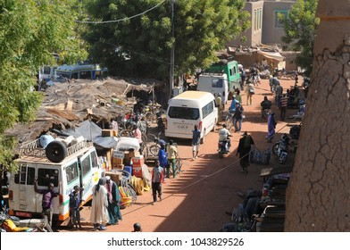 Djenne, Mali - December, 28, 2014: :People close the traditional market held each monday in front of the great mosque at djenne
