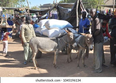 Djenne, Mali - December, 28, 2014: People at the traditional market held each monday in front of the great mosque at djenne