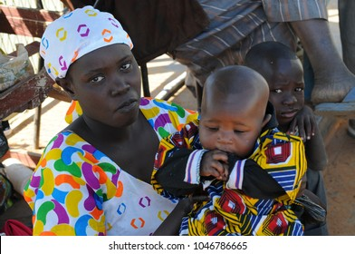 Djenne, Mali - December, 28, 2014: Young woman with child in a village of Mali