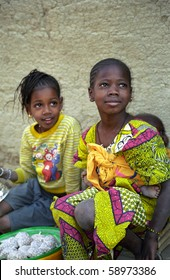 DJENNE, MALI - JANUARY 14: Fulani girls wait for their parents January 14, 2006, Djenne, Mali. Djenne is a hidden secret of Africa with its people.