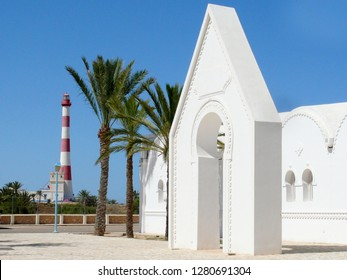 DJERBA EXPLORE Park/TUNISIA - May 3 2018: Buildings in park, and lighthouse  Phare Taguermess  in Tunisia. Djerba island. Northern Africa. Editorial use only.