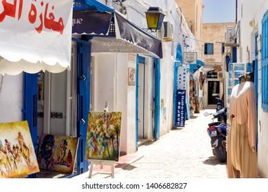 DJERBA, TUNISIA- APRIL 16: View of traditional shops in the medina market in Houmt El Souk in Djerba, Tunisia on April 16, 2018