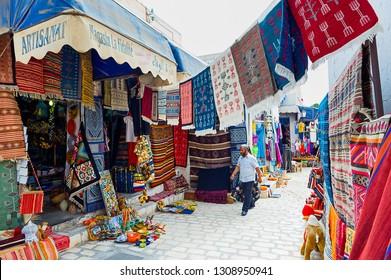 Djerba. Tunisia. (South Tunisia) Houmt Souk. 06/26/2014.  Carpets merchant at the Souk