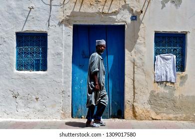 Djerba. Tunisia. (South Tunisia) Houmt Souk. 06/26/2014. Man walking at the Medina