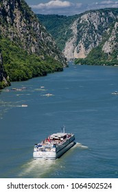 DJERDAP, SERBIA - AUGUST 15, 2016: Cruise ship on river Danube in Djerdap gorge in Serbia. At 2016 118 cruise ships with more than 18.000 tourists visited Djerdap National park.