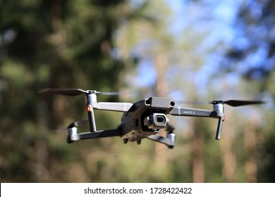 DJI Mavic 2 Pro flying in forest at difficult conditions. DJI Mavic 2 Pro drone testing in forest. Kaunas, Lithuania 20.04.2020 .