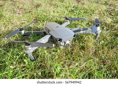 DJI Mavic Pro drone: Latvia JANUARY 25, 2017. Closeup on green grass background. One of the most portable drones in the market,with 4k ultra hd. Side view.