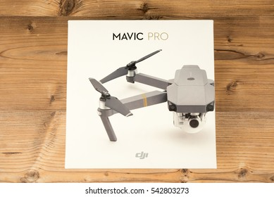 DJI Mavic Pro drone: Riga, Latvia DECEMBER 9,2016. One of the first DJI Mavic Pro drones shipped to Europe. Original box, closeup, on wooden background. One of the most portable drones in the market