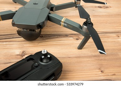 DJI Mavic Pro drone: Riga,Latvia DECEMBER 9,2016. One of the first DJI Mavic Pro drones shipped to Europe. Closeup,on wooden background. One of the most portable drones in the market,with 4k ultra hd