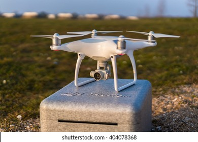 DJI Phantom 4 drone ready for take off standing on a case during sunset